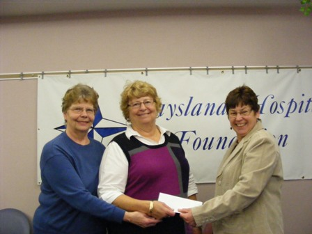 DHC_Ladies_Auxiliary_Purchases_5000_Brick_for_New_Daysland_Clinic_pictured_with_Martha_WaldorfFoundation_chair_-small.jpg